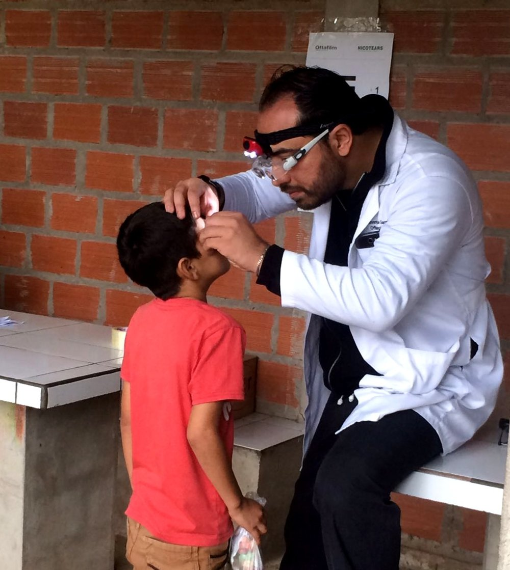 Dr. Jimmy Borda with a young boy
