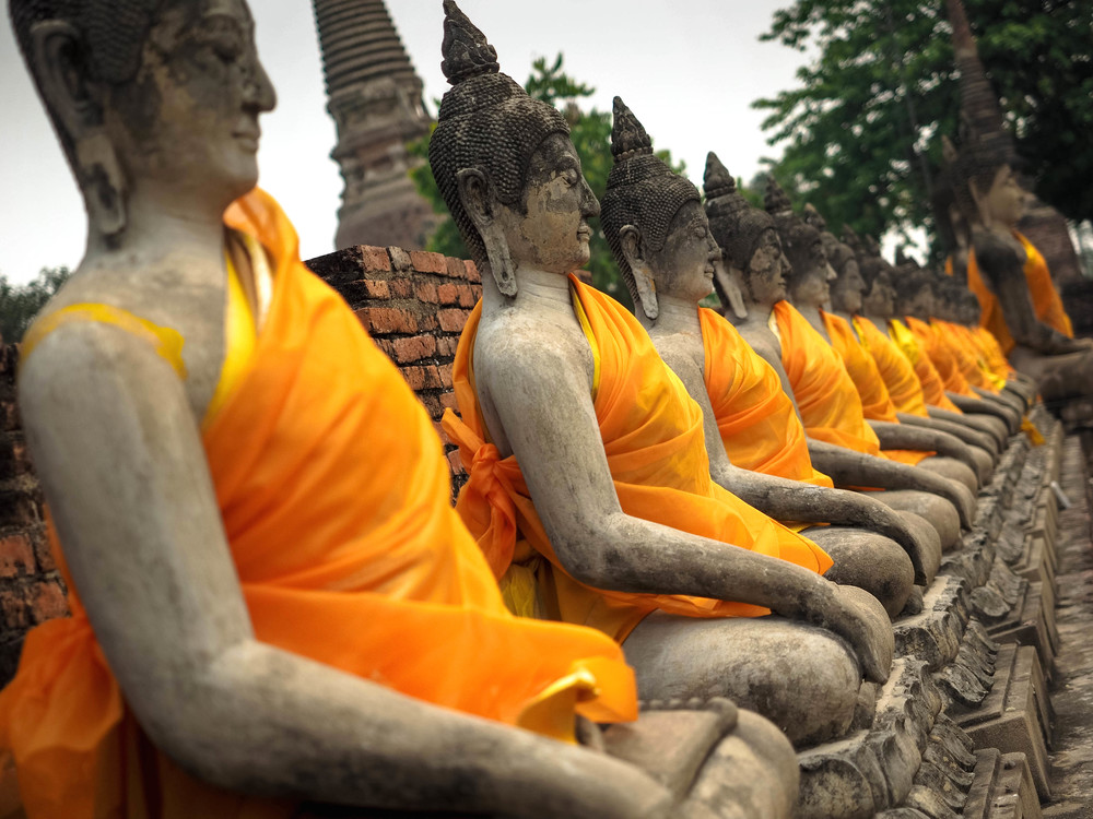 Rows of Buddas in Thailand