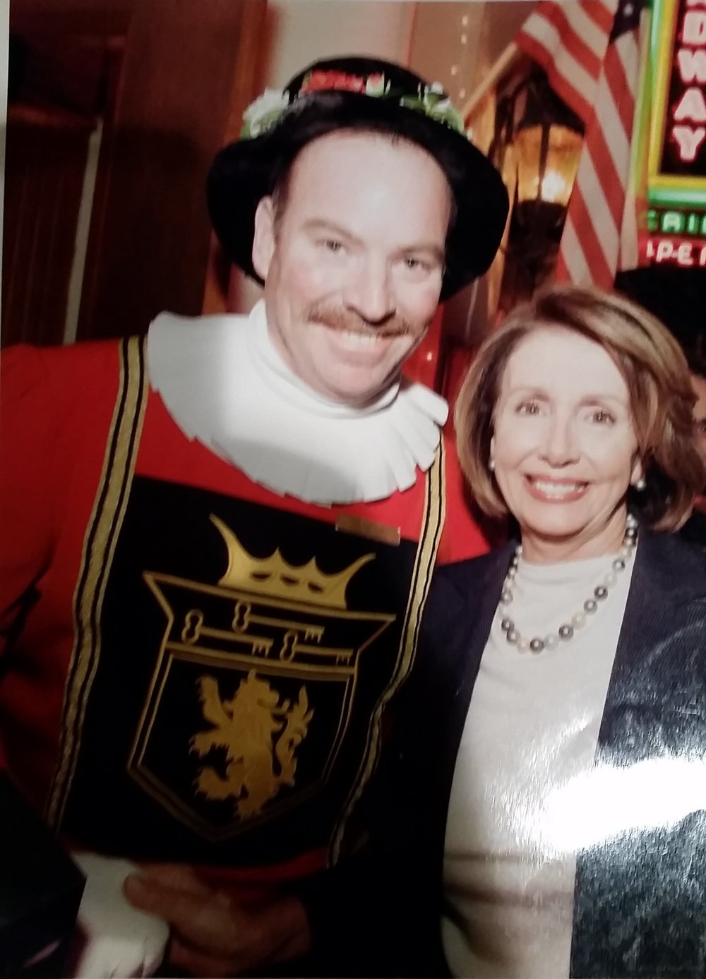With Nancy Pelosi, trying to look OK with someone putting a drink down without a coaster