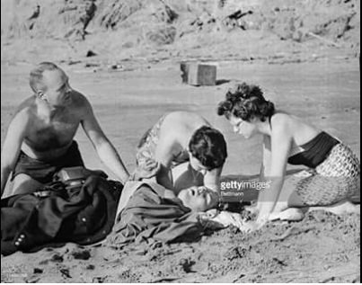 Shirley O'neill attends to Albert Kogler after shark attack 5-7-1959