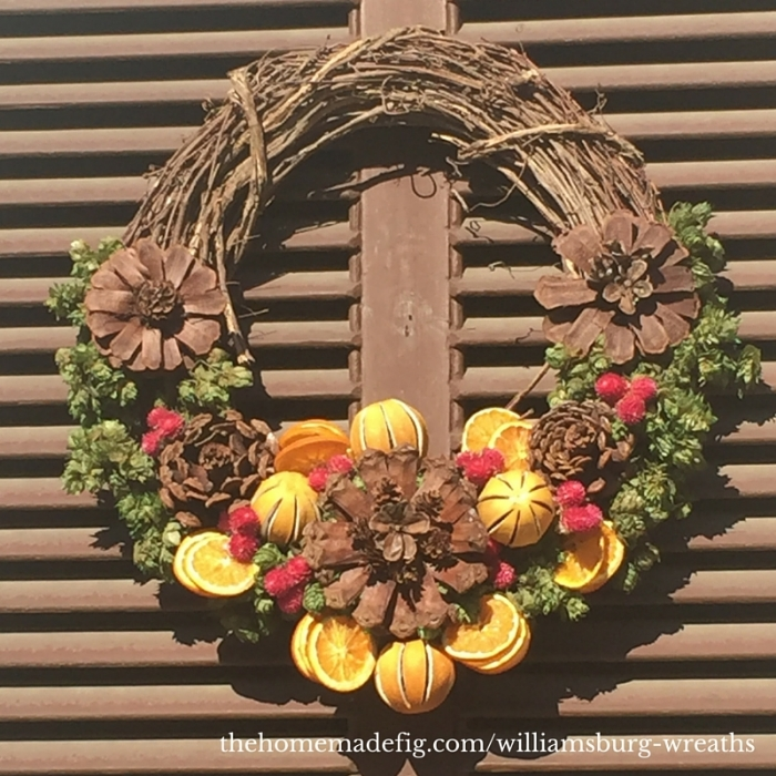 "This one is unique with it's partially exposed wreath, but it keeps to the symmetry principle.  The deconstructed pinecones into ""flowers"" is my favorite part!"