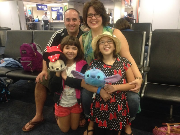 Waiting to board our cheap AA flight to Disney with 3 free military bags!
