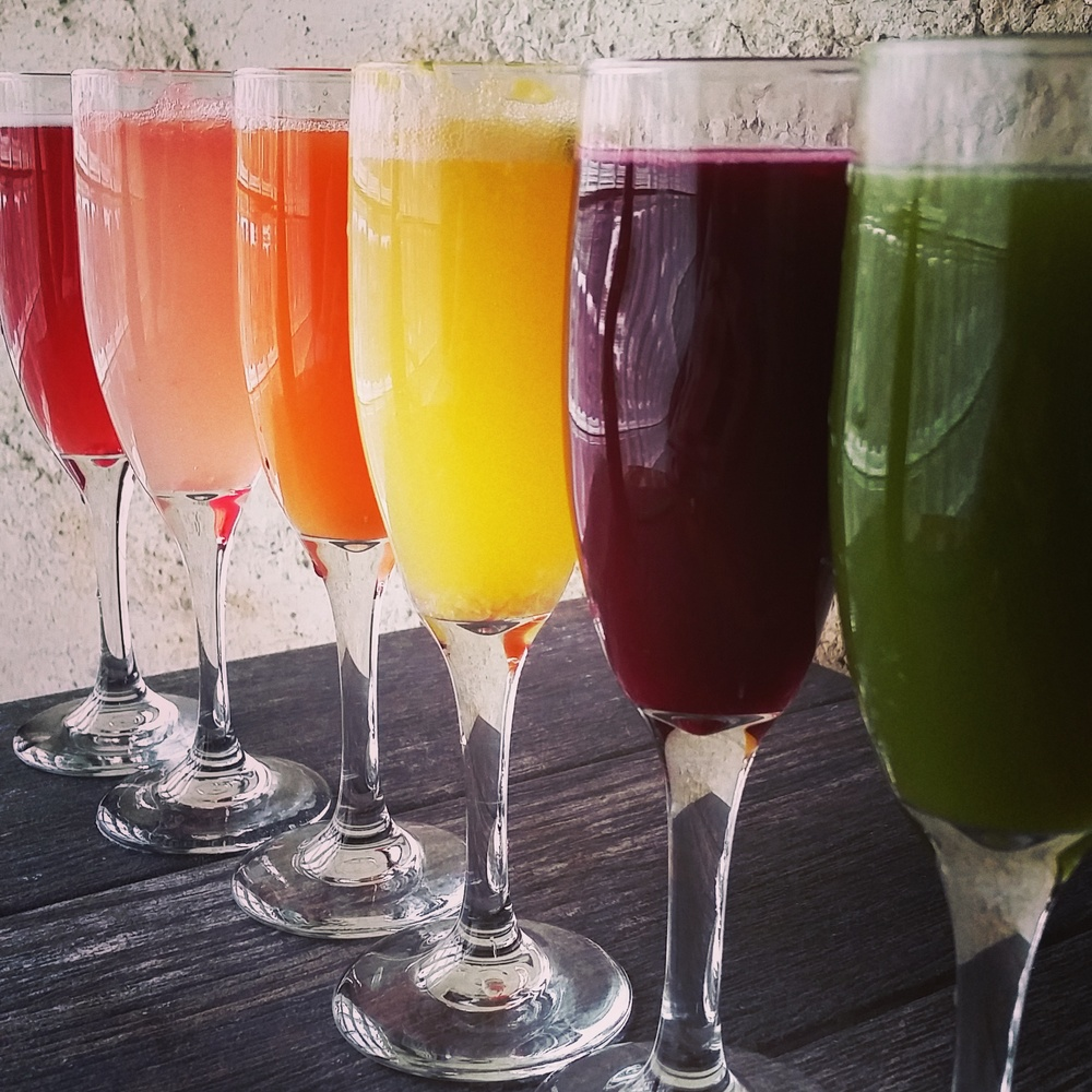 pomegranate, grapefruit, carrot orange, orange basil, beet ginger lemon, and our house green juice of the day which includes kale, apple, spinach, swiss chard, yeah we know it sounds weird but its amazing!