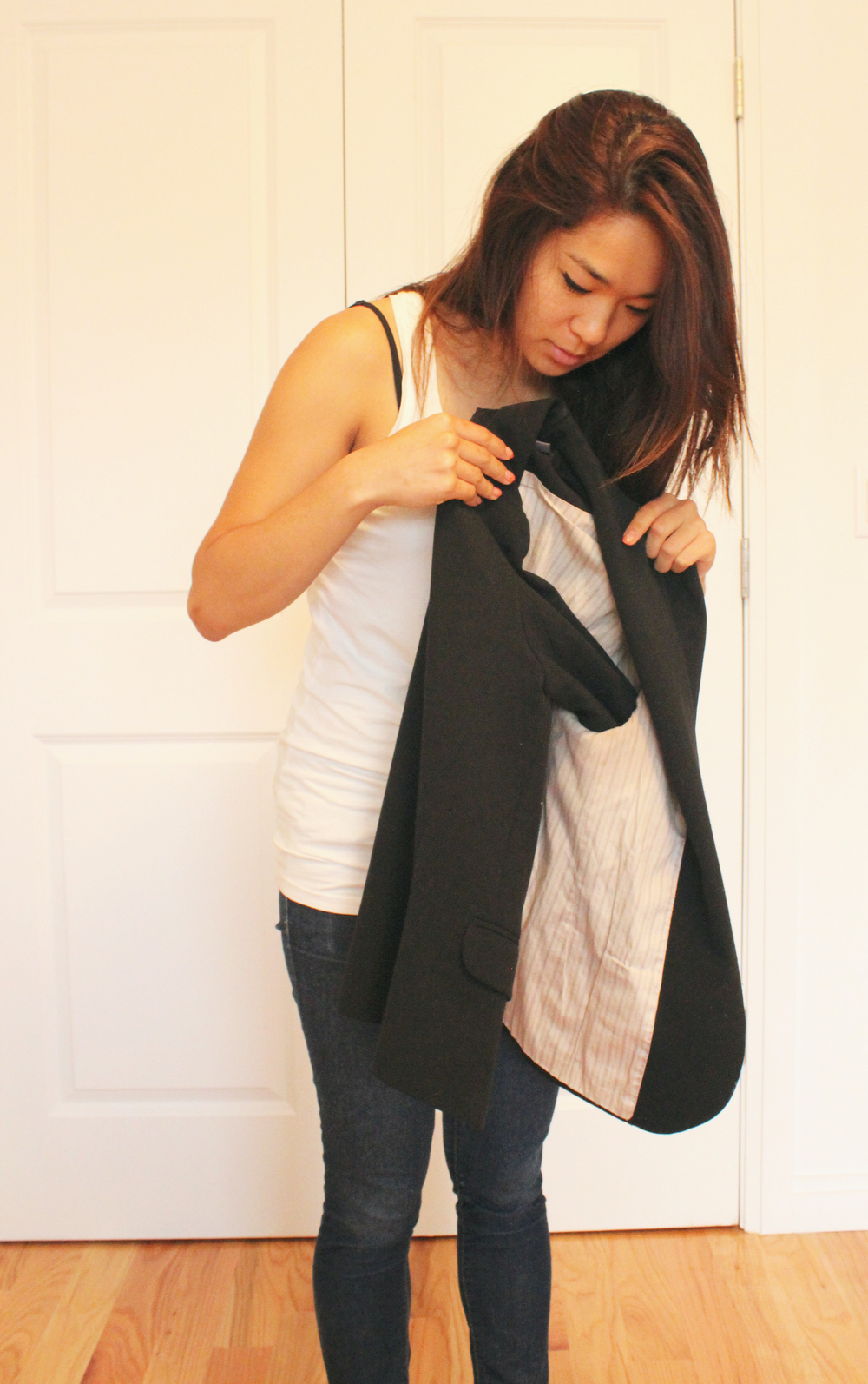 How to fold a blazer: put one of the sleeves into the other, it helps retain the shape