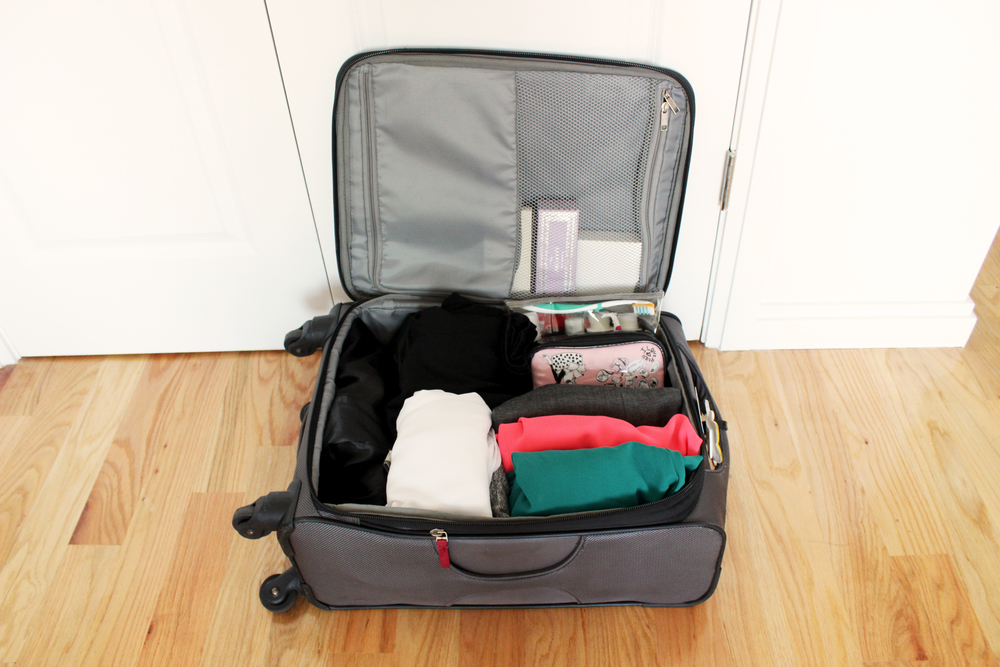 ALL DONE! Roll all your items to minimize wrinkles and to maximize space. Leave toiletries near the zipper opening in case you have to take it out for security. Pack shoes (and other heavy items) at the bottom of the suitcase so it doesn't press down on your clothes.