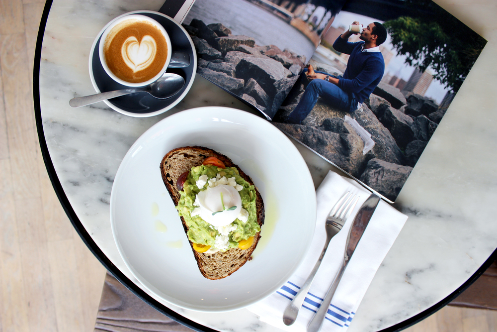 A delicious breakfast of a flat white and an amazing avocado smash with a side of DRIFT, a magazine focused on coffee.