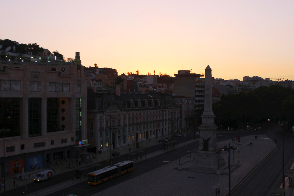 Watching the sunset from our balcony that overlooks the Praça dos Restauradores (Resauradores Square)