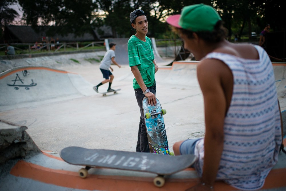 Orlando Enrique Rosales, 24, left, skateboards on a Sunday evening at a skate park in Havana. He has received equipment from Cuba Skate, a nonprofit organization in the United States. (Sarah L. Voisin/The Washington Post)