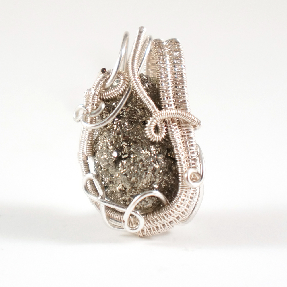 This wire wrap pendant was made with silver-fill wire (copper coated in silver) rather than pure sterling silver - but visually, they look the exact same!