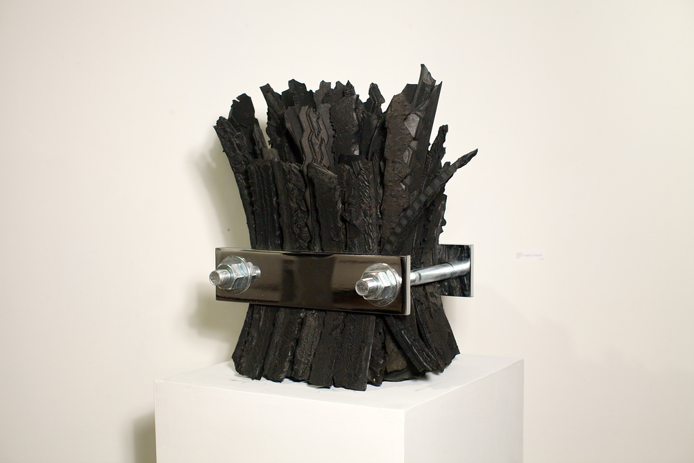 "Peter Hiers   Bound,  2013  found tire fragments, plated metal  18"" x 13"""