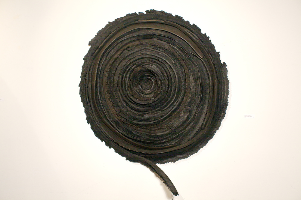 "Peter Hiers   Mythology Unraveling,  2005  found tire, rubber fragments  45"" x 8"""