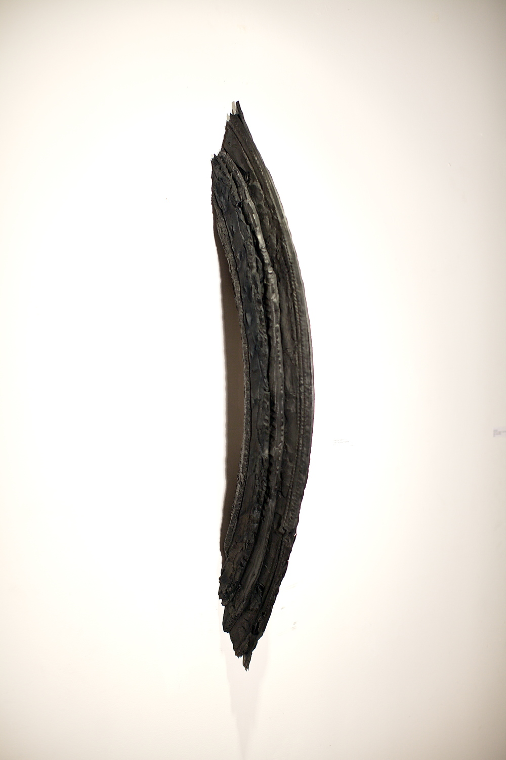 "Peter Hiers   Emerging Pattern,  2013  found tire, rubber fragments  9"" x 4.5"""