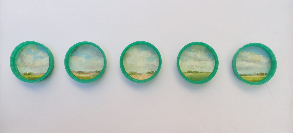 "Inguna Gremzde  Landscape for Emergency 12, 2012  Oil painting/found plastic  2.6"" x 5"" (framed), 1.6"" (diameter for each cap)"