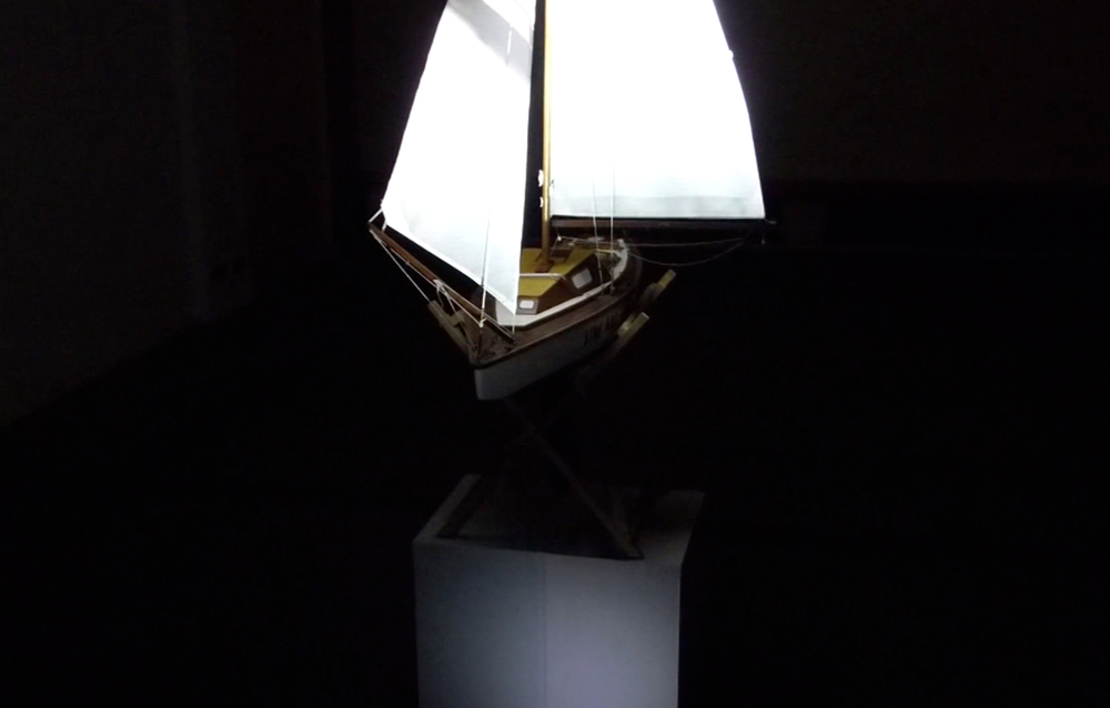 "Per Pegelow  P.A.U.L.A., Boat model  video projection, sound  53"" x 106"" x 24"""