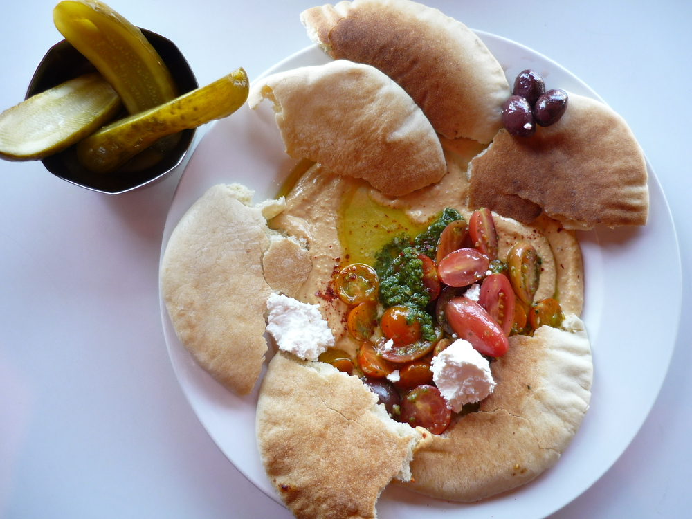 Hummus, zhoug, heirloom tomatoes from Terra Bella Family Farm and zhoug with side of locally grown and cured pickles from Alexander Valley - large file.JPG
