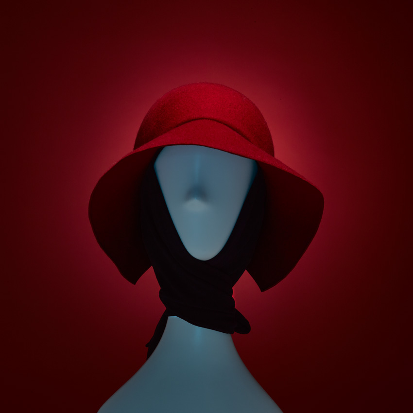 VARVARA RED   Hey there little Miss Riding Hood... Our VARVARA wool cloche with geometric cutout at neckline and attached black ultra-soft bamboo/ spandex scarf. 100% cotton Japanese grosgrain sweatband. Available in red and white with black scarf.   SHOP THE LOOK HERE!