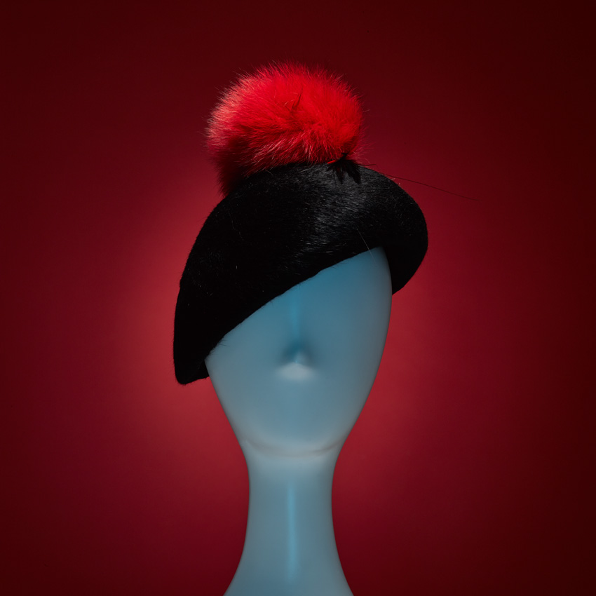SONIA    She's Foxxxy! Our SONIA beaver-finish rabbit felt beret with feather and oversized fAUX fur pom-pom embellishment. Hand-sewn Japanese grosgrain sweatband.    SHOP THE LOOK HERE!