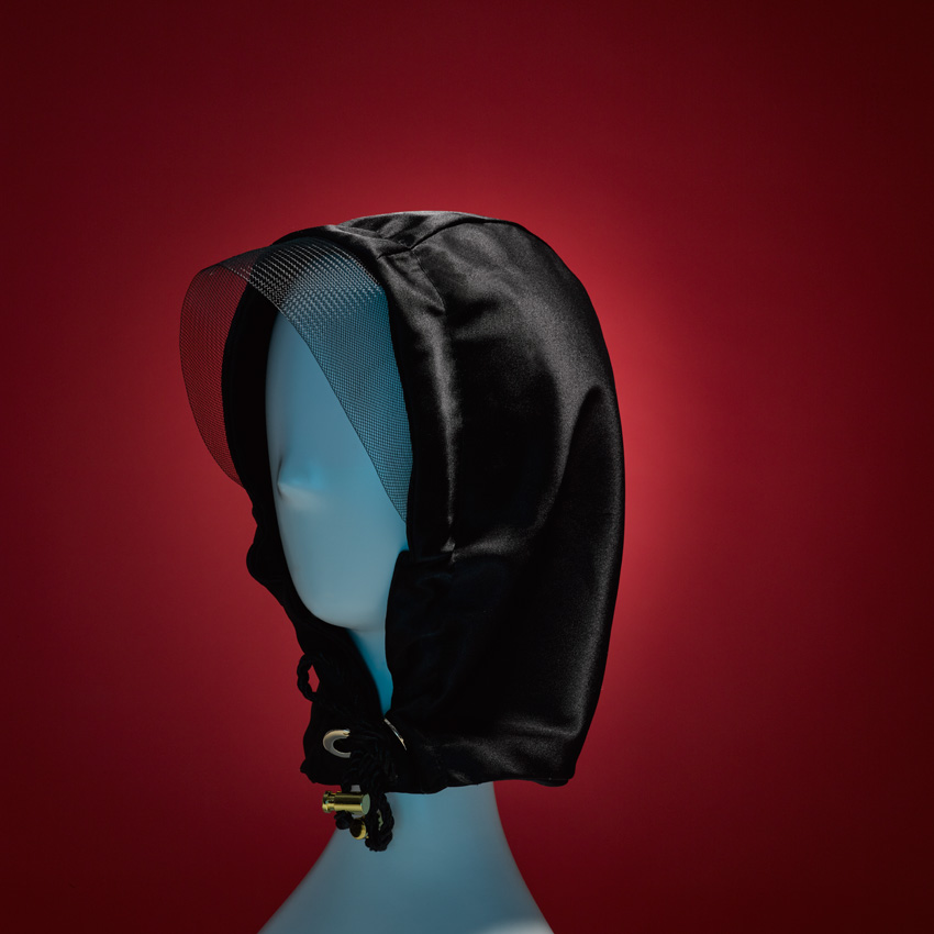 RIDING HOOD    Keep your head warm and your hair tangle-free! Our RED RIDING HOOD satin hood with horsehair visor and twisted satin stampede strings with brass embellishments. One Size.   SHOP THE LOOK HERE!