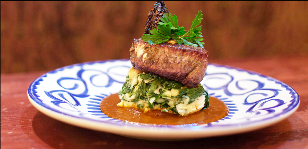 Filet mignon with seasoned goat cheese, mashed potatoes, sautéed spinach and chipotle chile sauce