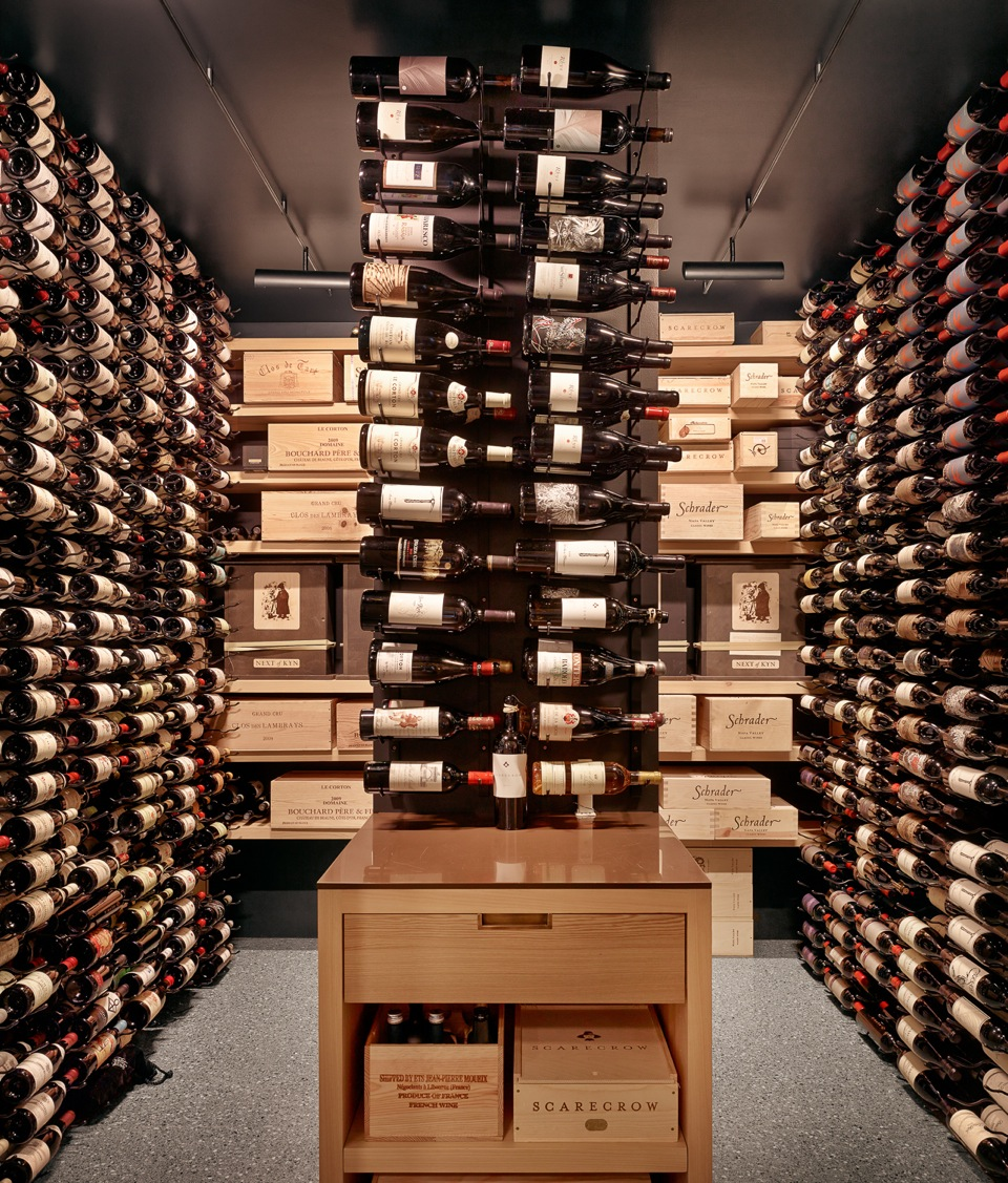 3000 bottle capacity wine room using triple-deep Vintage View label view racking with storage drawer, LED lighting, open + adjustable sinker cypress shelving for case display. Concealed mini-split cooling unit on backup generator.