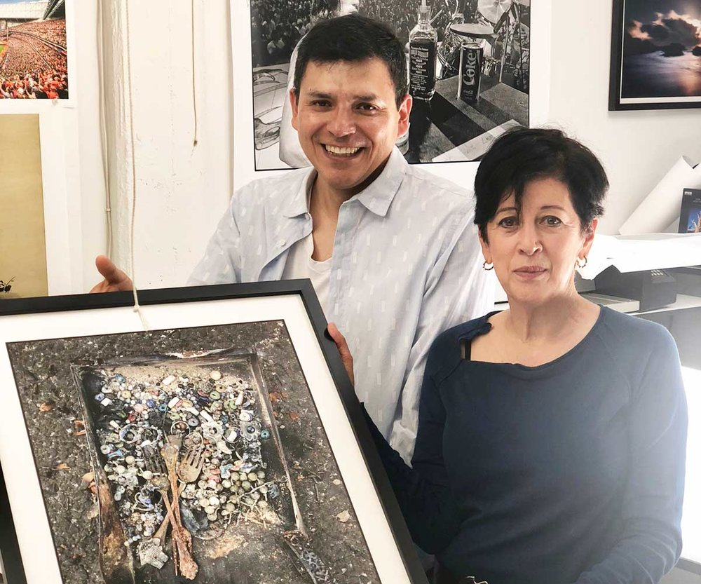 Gabriel Aguilar and Norma Quintana with a framed print from Forage From Fire.
