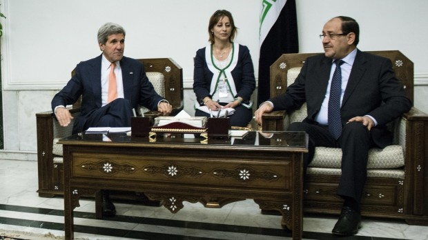 Kerry was in Baghdad to push for Iraqi unity and stability, as Sunni militants swept through western towns abandoned by security forces./   Brendan Smialowski AFP-Getty Images