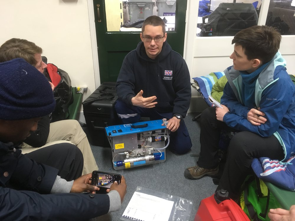 Operational IRT member Guy explaining the water filtration system to new Serve On International Response Team recruits.