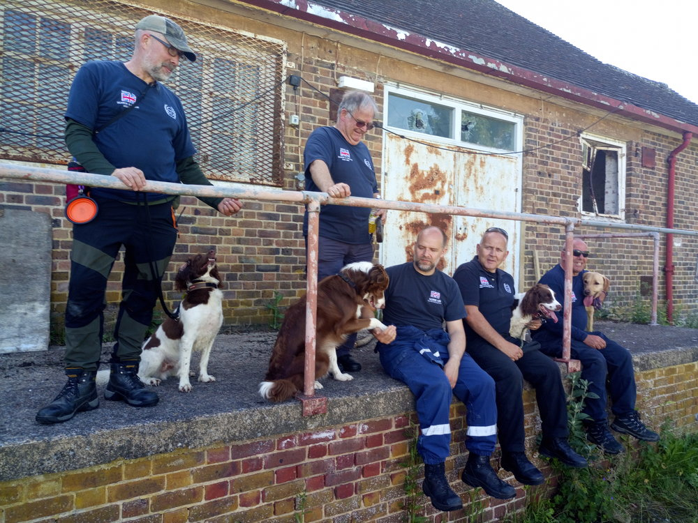 Members of Serve On's K9 Search and Rescue team take the weight off their feet/paws after a busy weekend's training.