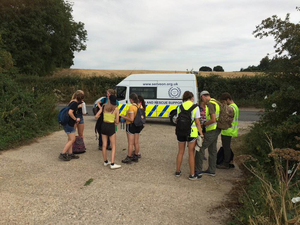 The Team 7 NCS youngsters prepare for their 10-mile walk in aid of Headlight, with transport and safety support from Serve On volunteers.