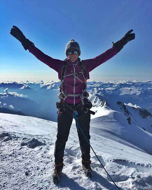 Serve On International Response Team volunteer Clare Lobb stands at the summit of Mont Blanc.