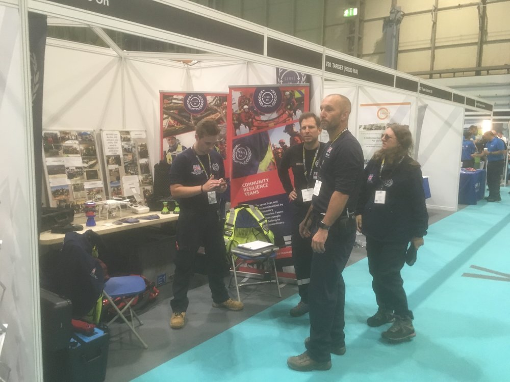 Serve On volunteers Matt, Benjamin, Steve and Louise manning the stand at this year's @emergencyukshow