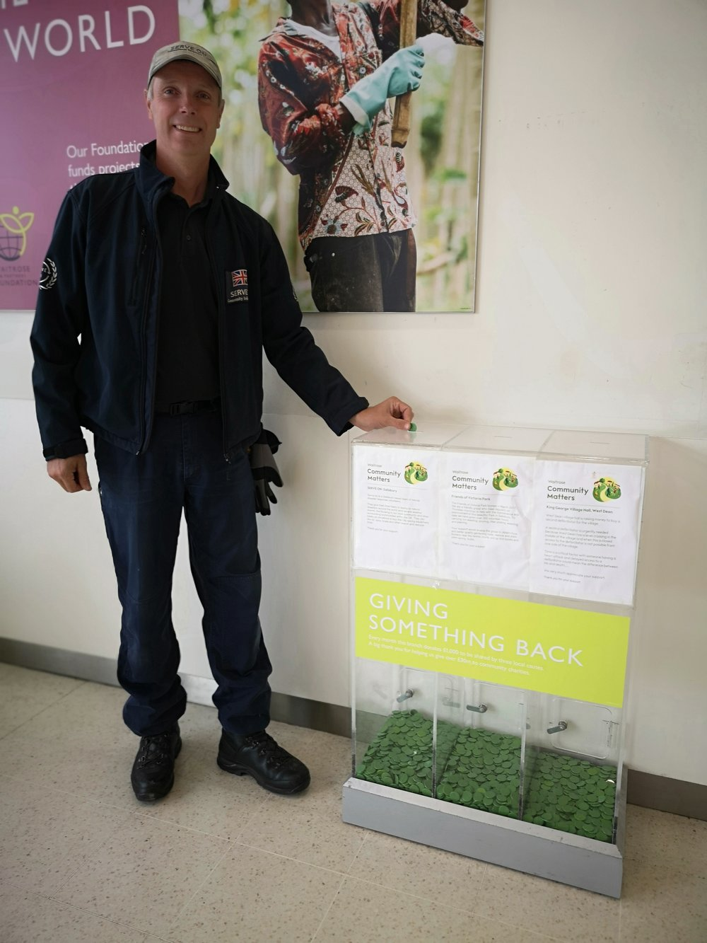 Serve On Operations Manager Craig Elsdon adding a token to the Community Matters boxes at Waitrose in September