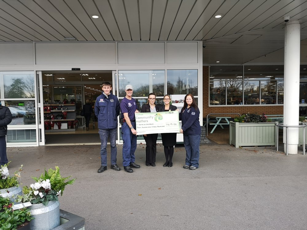 Waitrose and Serve On staff show off the generous cheque realised thanks to shoppers at the Salisbury Waitrose store who voted in the Community Matters scheme.