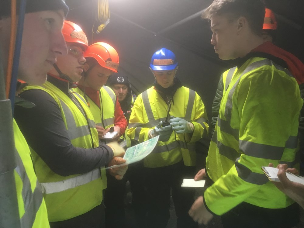 England U20 rugby stars are briefed on disaster response scenario by search and rescue volunteers from humanitarian charity Serve On