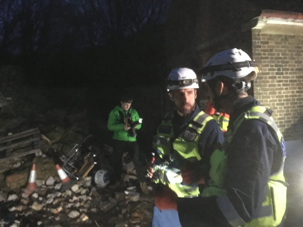 England football head coach Gareth Southgate and other elite UK trainers rescue casualties from a 'collapsed building' during a disaster experience exercise with Serve On humanitarian response charity.