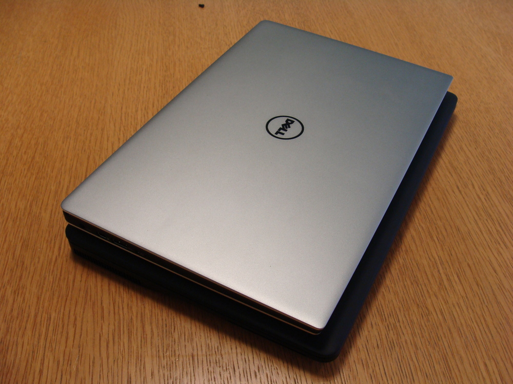 The XPS 13 sitting on my Latitude E7250 - smaller, slimmer and lighter and with one more nice twist