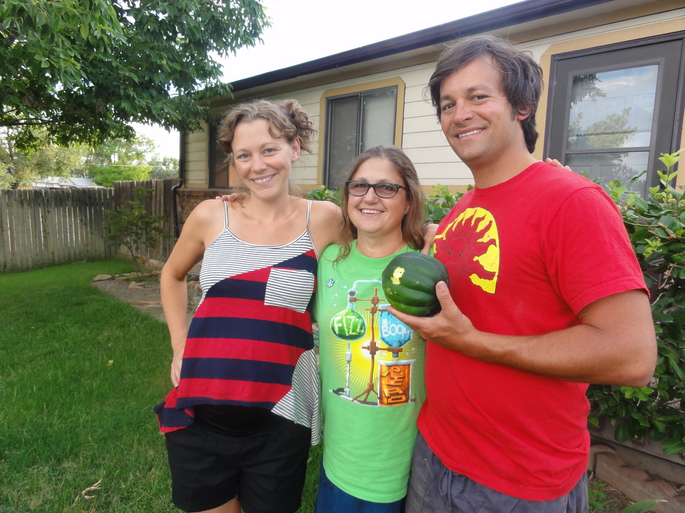 Us with Gail and a freshly picked squash in front of her house