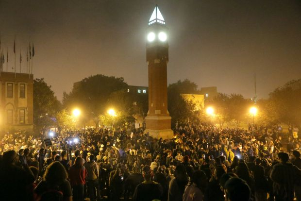 Protestors gather around the clock tower at SLU late Sunday night. Photo by David Carson of the St Louis Post-Dispatch.