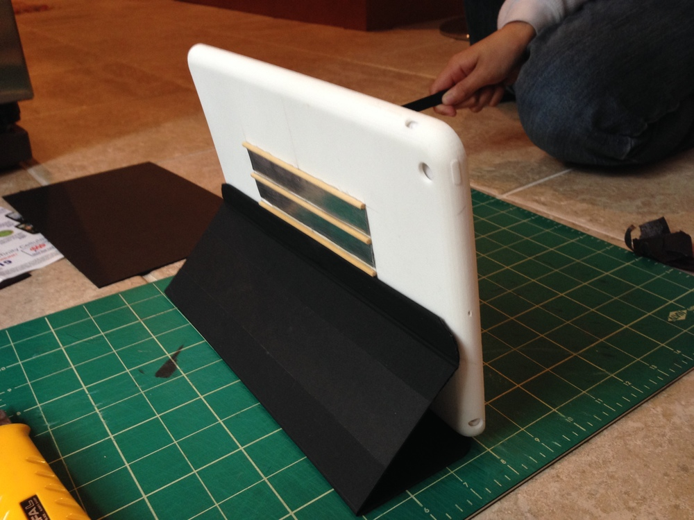 A matte board cover case was then scored and embedded with magnets to create a iPad cover and multi-position stand.