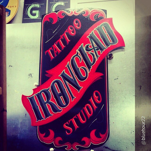 ORIG-an-nbsignsoriginaldesigns-by-the-hand-of-aaron_cruse-for-an-ink-shop-in-jacksonville-florida-reposted-from-bluehour23-handpainted-signpainting-tattoo_15725738131_o.jpg