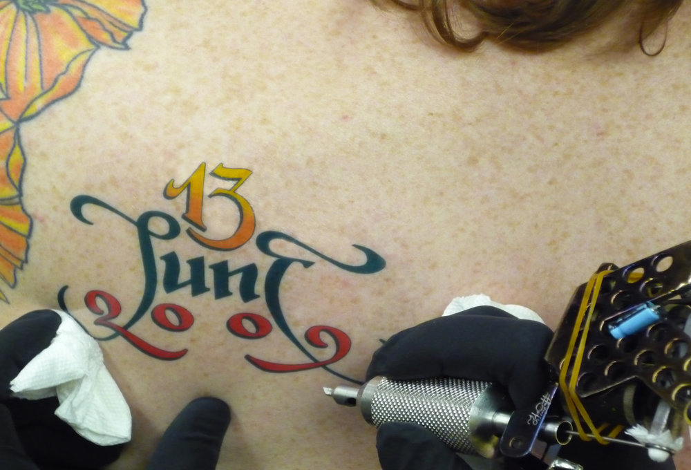 ORIG-tattoo-close-up-with-gun_3373572670_o.jpg