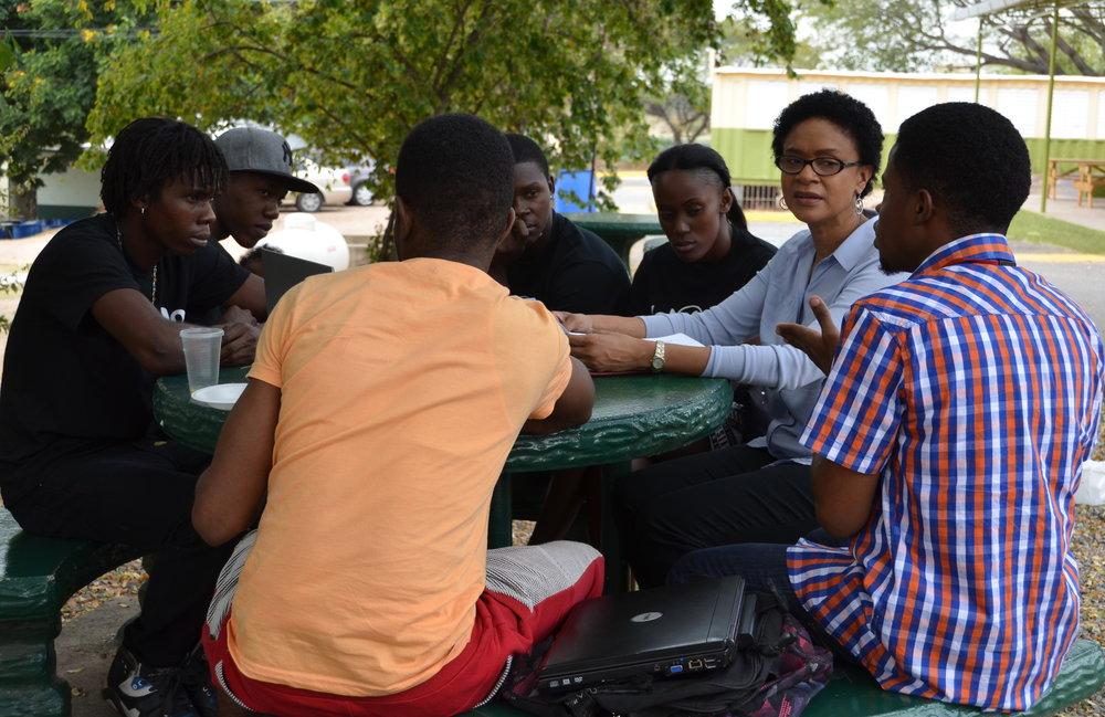 We design programs to serve individuals living in high-risk communities in Jamaica.