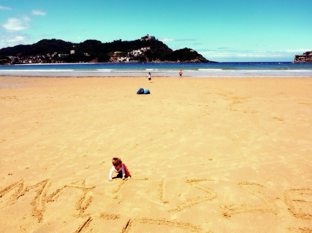 Luke helped Matisse write her name in the sand.