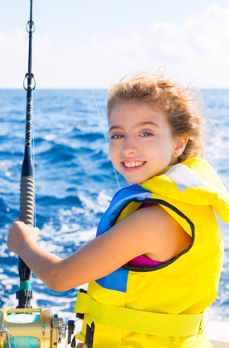 Girl in fishing off Warrior