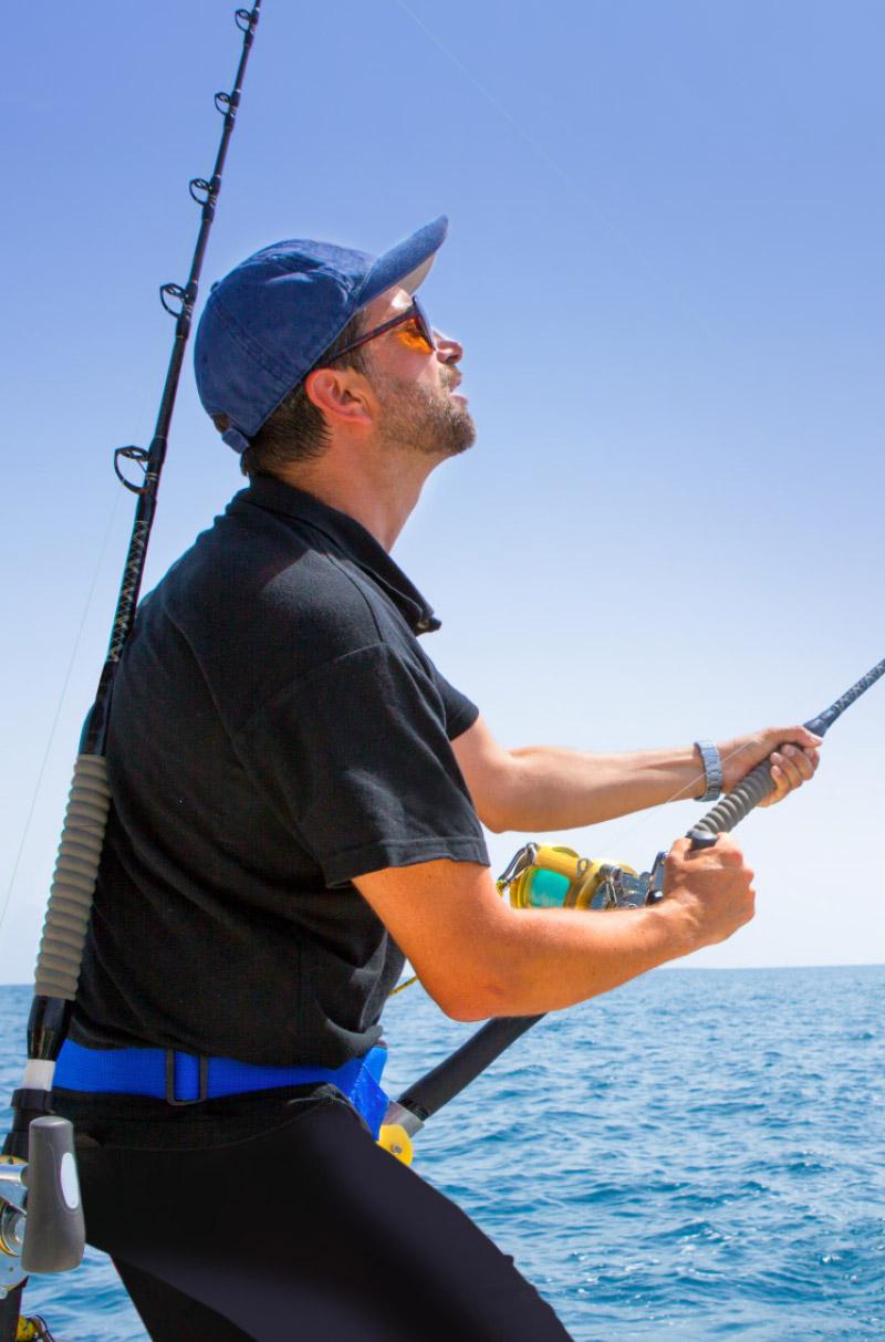 Man fishing fishing off Warrior Hardtop