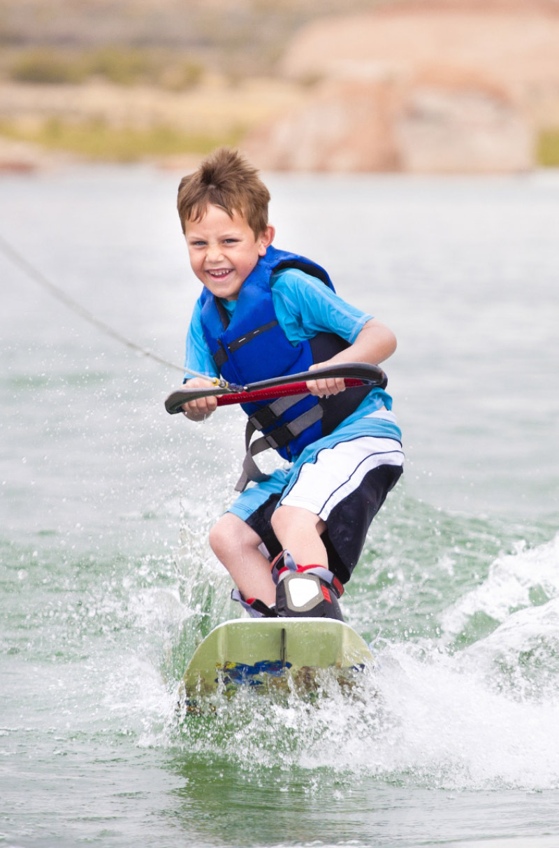 Boy wake boarding off Dominator