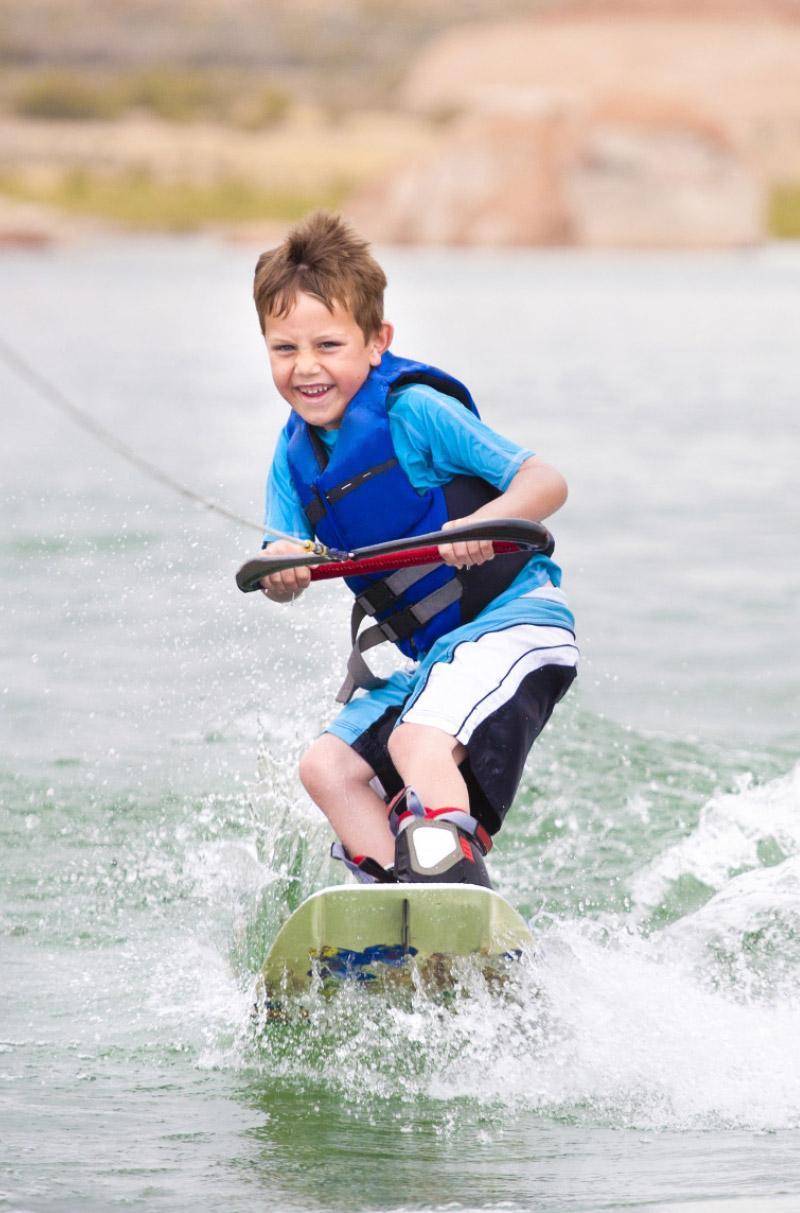 Boy wake boarding off Dominator