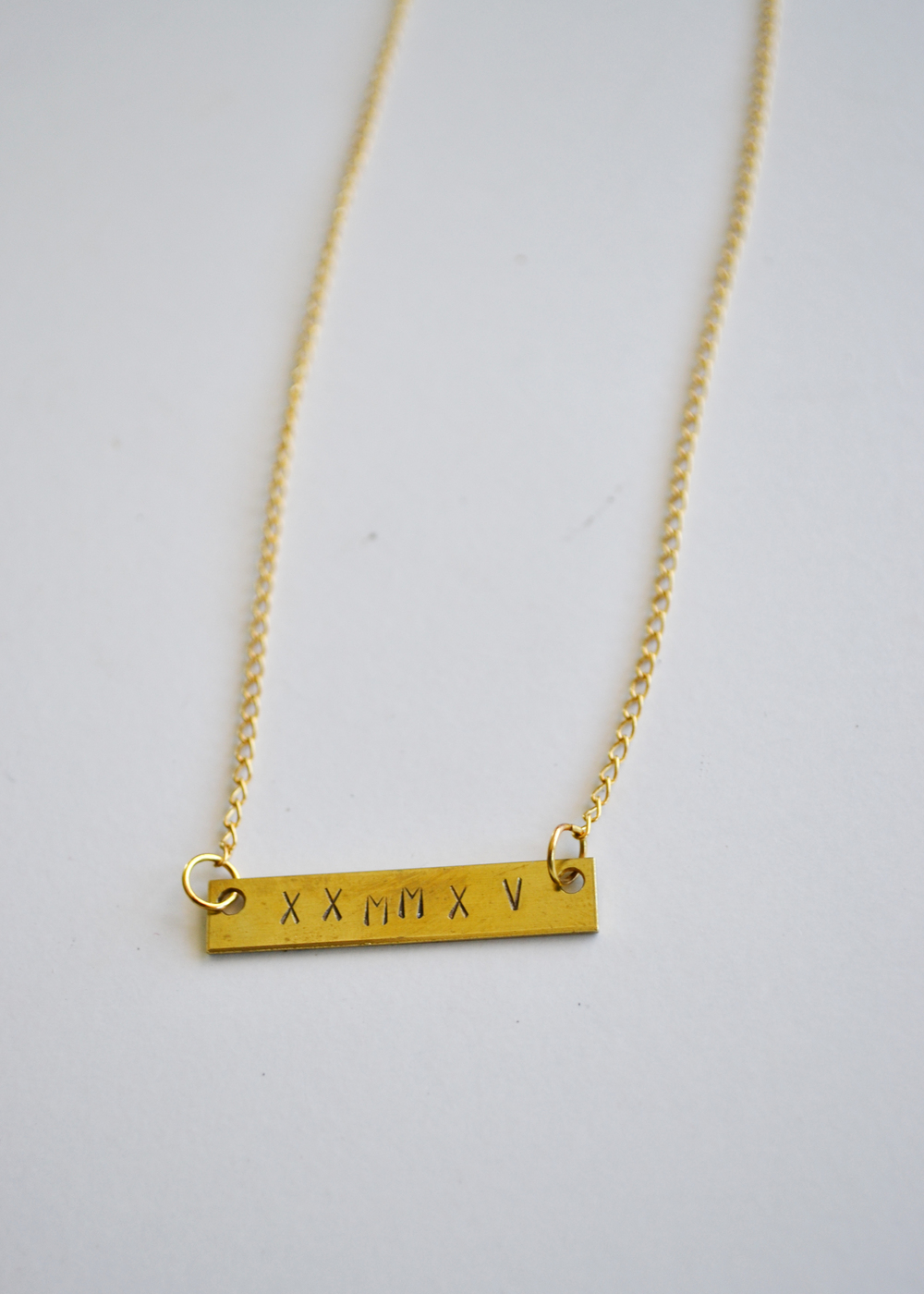 Adorable DIY necklace with special dates stamped in. Would be perfect for a shower or wedding gift. From boxwoodavenue.com