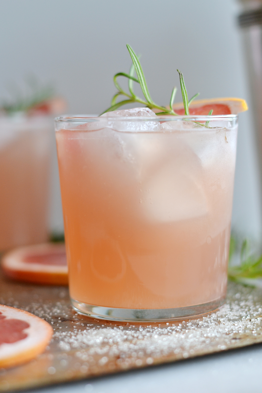 Pretty pink cocktail! Super refreshing rosemary greyhound from boxwoodavenue.com