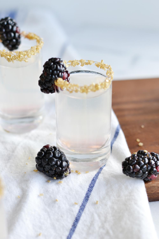 Add gold sanding sugar to shot glasses, such a fun party idea! boxwoodavenue.com